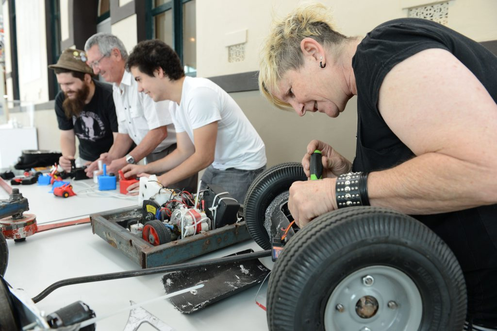 EXTERMINATE, EXTERMINATE: Julie Pitts (right) works to get her robot Ringo battle ready for the Australian Robowars Nationals this weekend at the Ipswich Art Gallery.