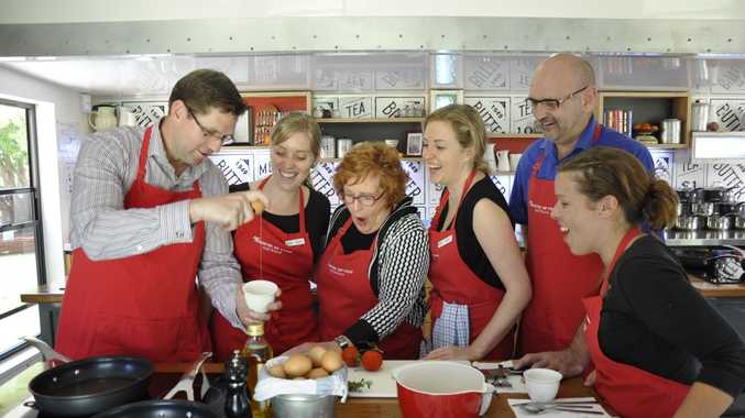 Cr Geoff McDonald, food trainers Renee Truscott, Cr Sue Englart, Sarah Campbell, Colin Mackay and Nikki Kavanagh launch the start of cooking classes at the Jamie's Ministry of Food mobile kitchen which will be parked in Queens Park for three months.