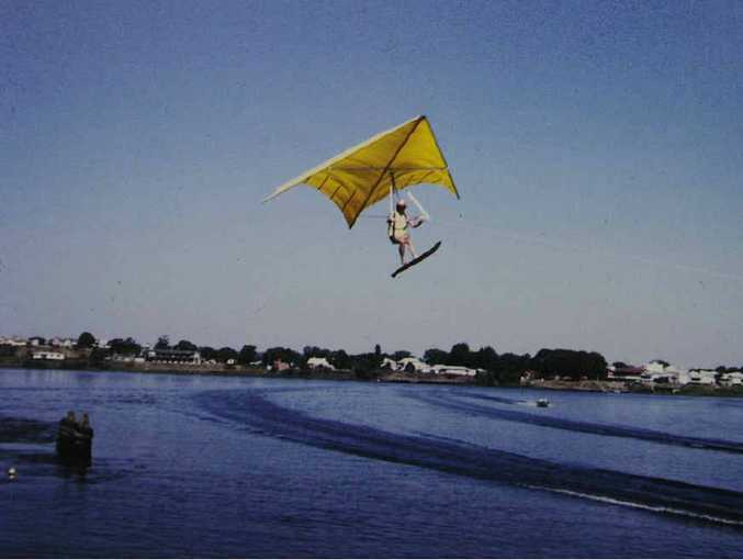 UP AND AWAY: Les Hill's photograph of Rod Fuller flying the John Dickenson designed hang glider for the first time, towed by a boat driven by Pat Crowe. INSET: Len Hill with the photo. PHOTO: JOJO NEWBY