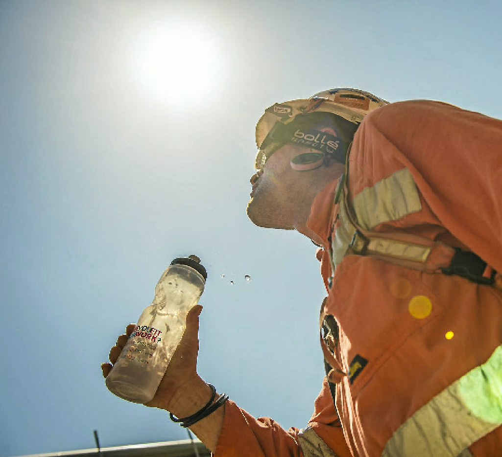 DRINK UP: Terry Tydd keeps hydrated at the Rio Tinto Alcan refinery at Yarwun.