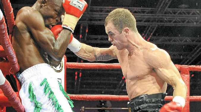 Australian boxer Jarrod Fletcher lands a big hit on Ghanaian Philip Kotey during their fight in May.