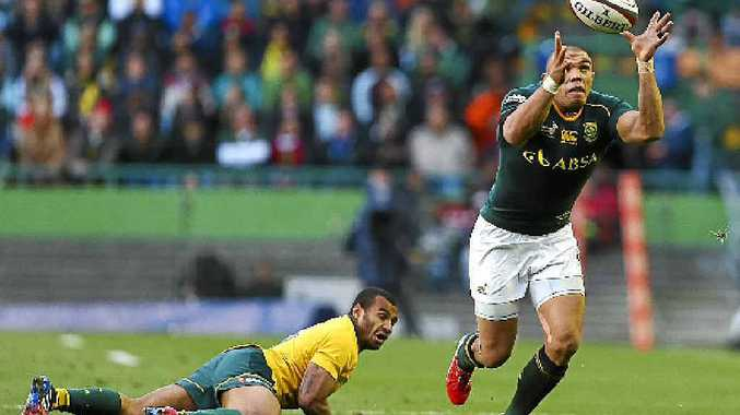 FLY BY: South African winger Bryan Habana leaves Australia's Will Genia in his wake during their Cape Town clash.