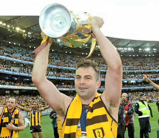 LIFE OF BRIAN: Hawthorn's Brian Lake holds aloft the premiership cup.