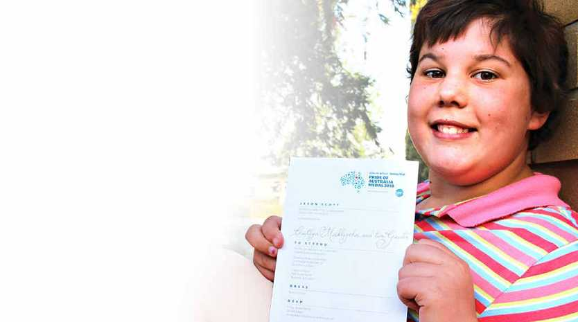 Finalist Caitlyn Meiklejohn shows off her invitation to the Pride of Australia Medal ceremony.