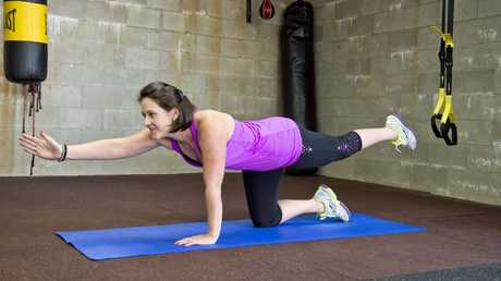 Danielle Brown demonstrates yoga with suspensions at Complete Body Yoga and Fitness.