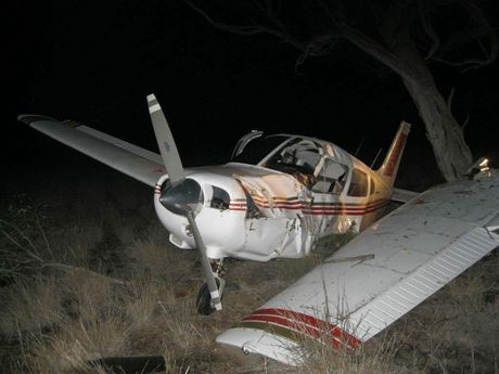 A Piper Warrior II rests in a paddock north of Cunnamulla after the pilot lost power and was forced to crash land.