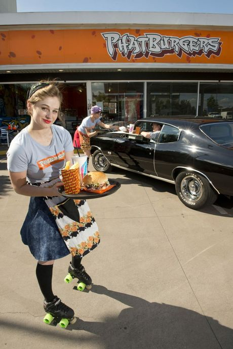 Waitresses (from left) Esther Steffens and Rachel Bailey serve an in-car burger to Richard May-Steers. Phatburgers' new 221 Ruthven St store offers roller-skate service during the day on Wednesdays and day-and-night on Thursdays and Fridays.