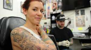 True Colours tattoo studio's Chris Bartlett isn't concerned about new research that suggests tattoo ink can cause cancer. Robyn Hoole, 24, has four tattoos and two sleeves and isn't worried about research that suggests tattoo ink can cause cancer.