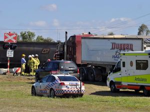 Truck driver walks away from collision with coal train