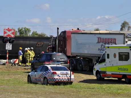 Emergency services at the scene of a collision between a road train and coal train on Jandowae Rd at Dalby.