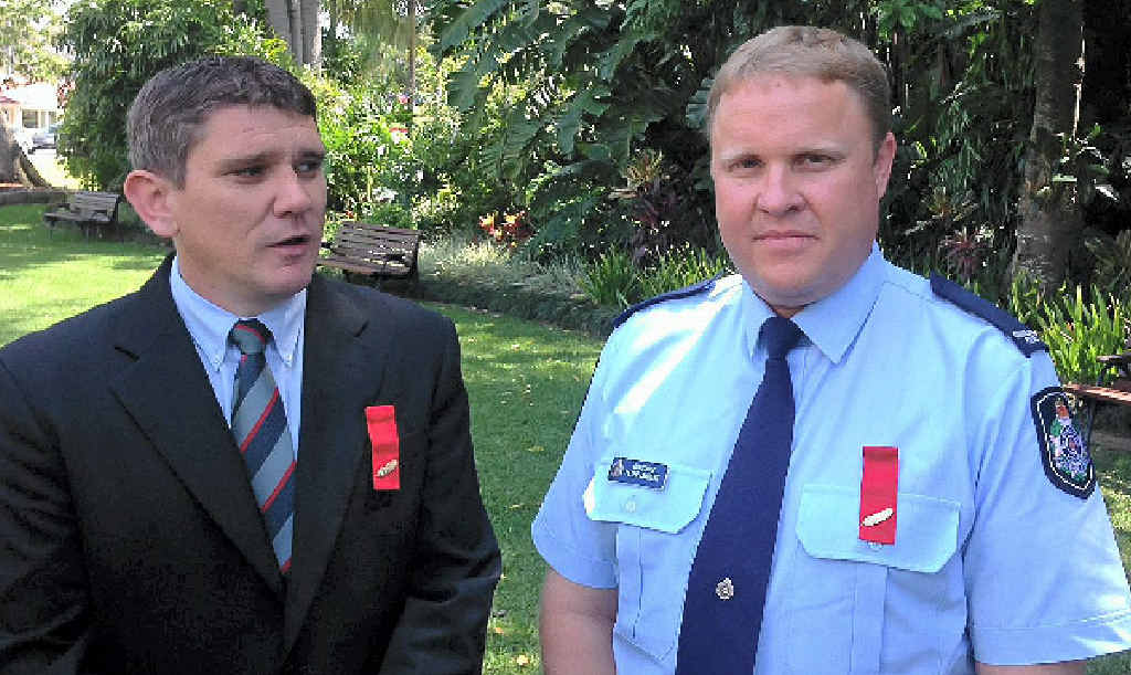 JOB WELL DONE: Helicopter pilots John (left) and Simon McDermott were awarded a group bravery citation for their work during the floods.