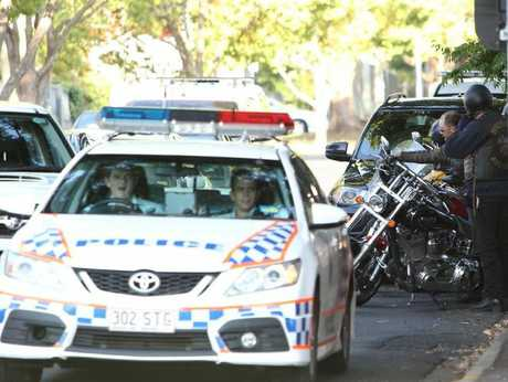 Police swoop on members of the Highway 61 motorcycle gang outside the Spotted Cow in Toowoomba.