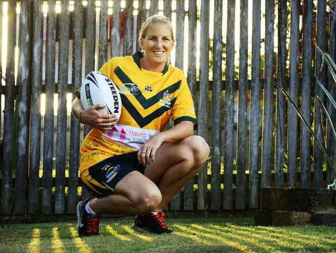 WORLD'S BEST: Ipswich rugby league player Ali Brigginshaw wears her World Cup jersey signed by all the victorious Australian players.