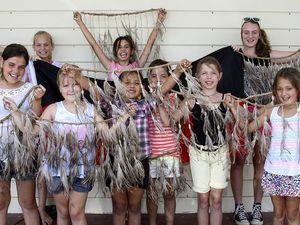 Children make emu feather skirts at holiday workshops