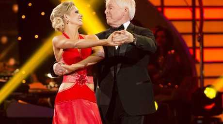 Tony Barber performs the Foxtrot with his Dancing With The Stars partner Melanie Hooper in the 2013 series debut show.
