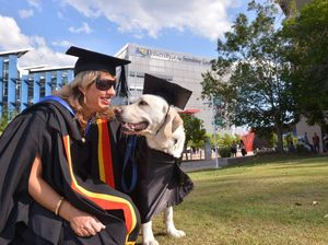 Nev the dog takes a bow for degree in patience