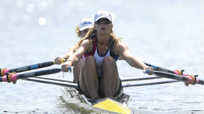 TEAMWORK: Lower Clarence Rowing Club members Tegan McFarlane and Gemma Dane row to a win in the Women's Open Double Scull at the Lower Clarence Rowing Regatta. PHOTO: ADAM HOURIGAN