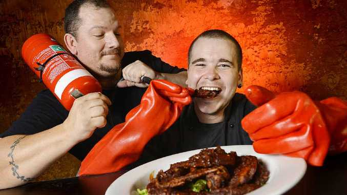 Wotel Metropole owner Jason Trembath and head chef Michael Barton prepare to try the Extremely Insane Hot Chicken Wings.