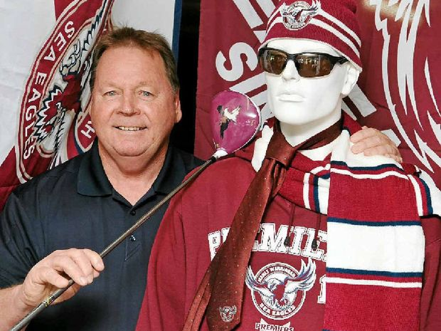MANLY MAN: Beerwah golf pro John Mellish with his shrine to the Sea Eagles.