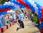 Tacey Siddins jumps for joy as she crosses the finish line in the 10km run at the CQ Physio Spring Classic Fun Run at Yeppoon. Photo: Chris Ison / The Morning Bulletin