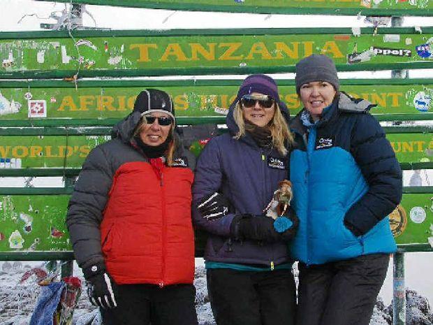 Debbie Ladd, Sandi Barrett and Sam Juniper at the top of Mount Kilimanjaro.