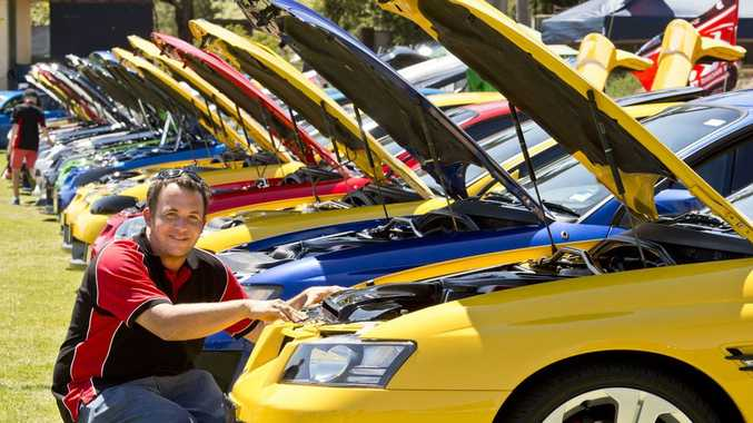 Jarrod Wilcox inspects his VZ Clubsport at the All Holden Day at Toara Park.