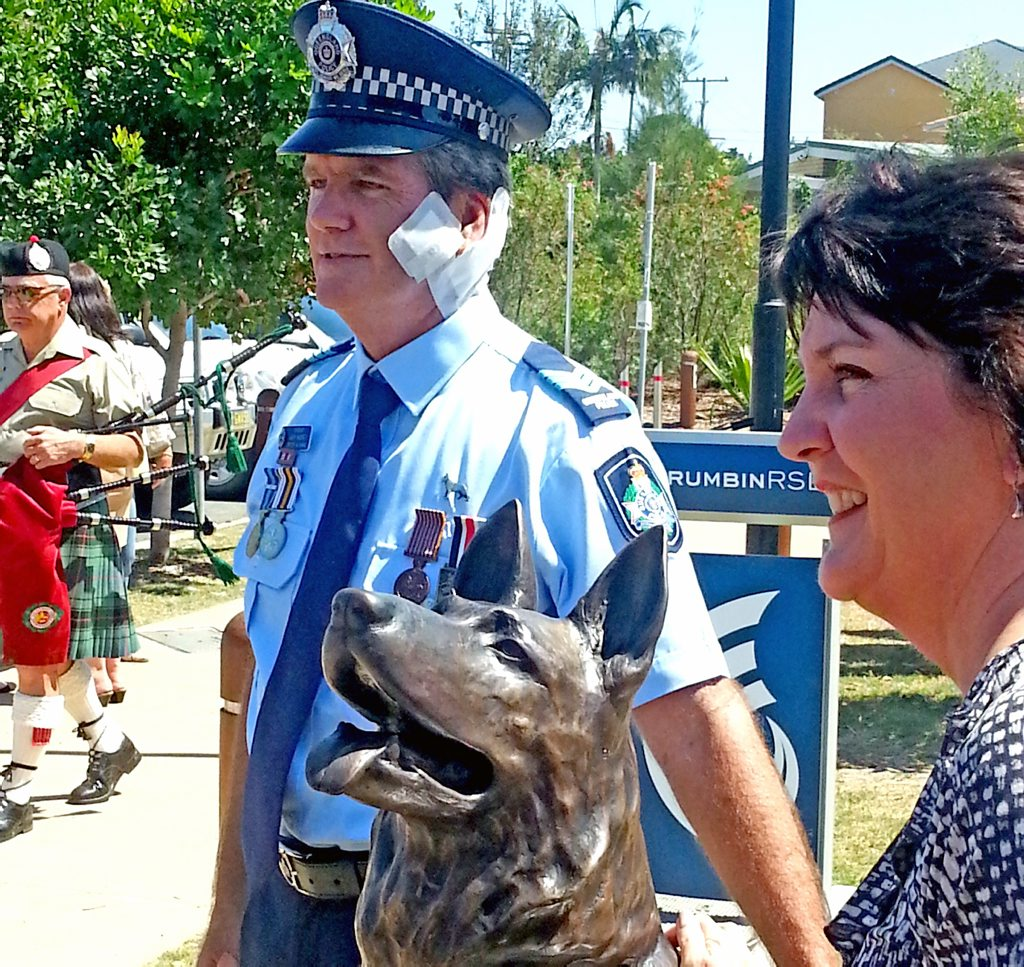 Gold Coast Police officer Gary Hamrey and Jann Stuckey at the Animal Heroes statue at Palm Beach parklands.