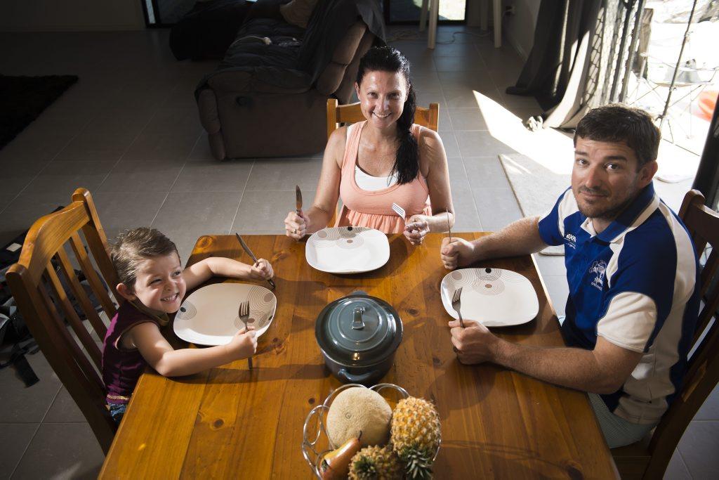 Bryton, 4, Linda and Randy Hayward at their family dinner table.