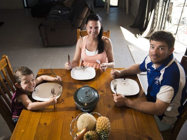 Bryton, 4, Linda and Randy Hayward at their family dinner table.