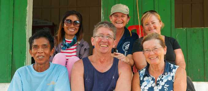 WORKING BEE: Toni Kearney and Trevor Smith with other volunteers in Cambodia.