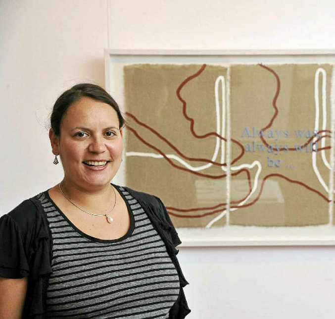 Frances Belle Parker with last year's winning artwork in the Clarence Valley Indigenous Art Award. Photo: Adam Hourigan