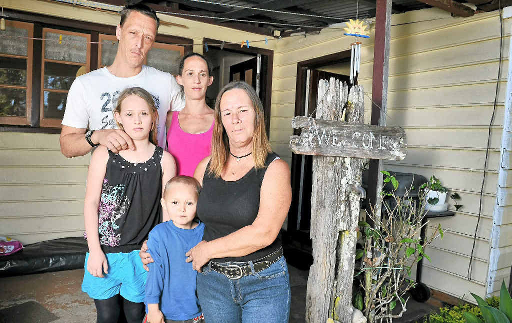 UNUSUAL SITUATION: Lyn Oakley (right), of Mullumbimby, with family members John Oakley, Rebecca Dudgeon, Mya Oakley, 11, and Lachlan, 4. Lyn has been issued a massive rent increase for the land on which her railway cottage has been on for more than 100 years.