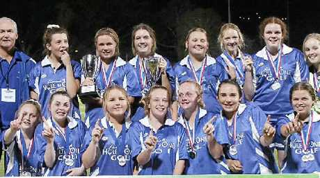 CELEBRATION TIME: Lismore Thistles grade 15 women's football coach Paul Albertini (back row, far left) and players after capturing 2013 grand final success.