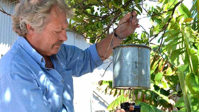 Mackay Regional Council's Vector Control team leader Don Chatham with a light trap used to catch mosquitoes.