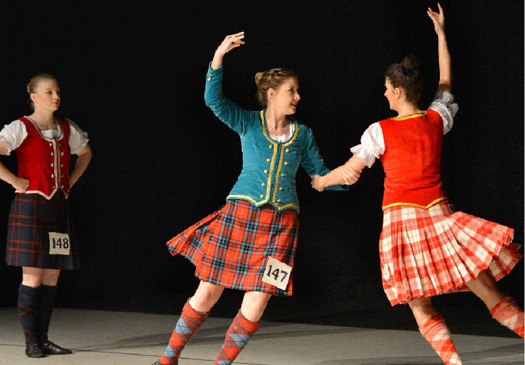 Kristy Rutherford, Amanda Goodwin and Crystal Danastas dance in the Premier Highland Title 17 years and over section at the Mackay Eisteddfod.