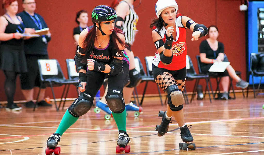 ROUGH ROLLERS: This Harbour City Hustler is about to take out her opponent at the at Tropicarnage, Caboolture.