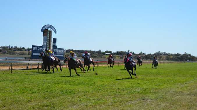 Zed Man (centre) arrives in time to win last year's Warwick Cup at Allman Park.