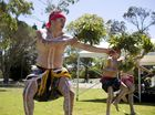 (From left) Damon Anderson, Terell Anderson and Massey Collins dance with the William Haupt Aboriginal Dance Troupe.