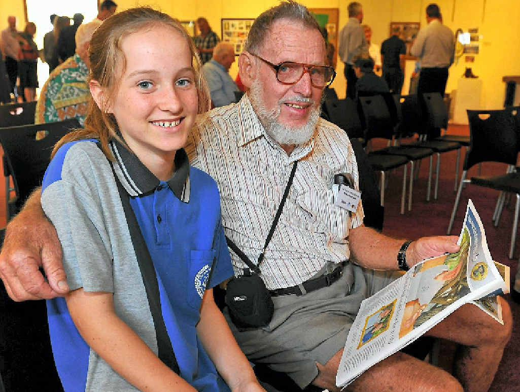 FUN HISTORY LESSON: Year 8 student Mia Hornby looking at the new publication with Ken Whittaker.