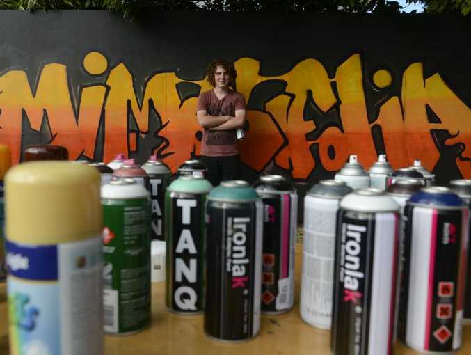 Kade Valja, 16 paints his street art on a wall provided by council at the Grafton Regional Gallery Photo Adam Hourigan / The Daily Examiner