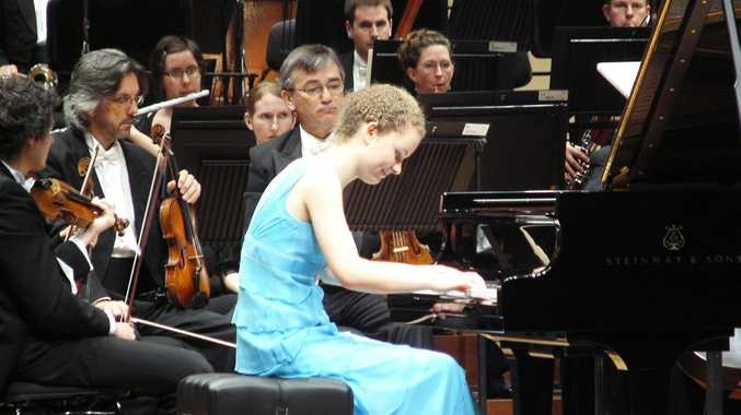 Ayesha Gough giving it her all on the piano backed by an orchestra.