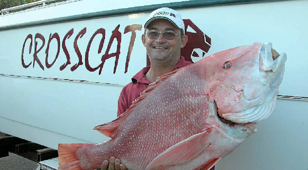 NICE ONE: Agnes Water recreational fisherman Mark Cross and a nice red emperor.