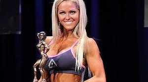 Alicia Gowans from Design Your Body Studio in Camp Hill with her bodybuilding award. Photo: Supplied