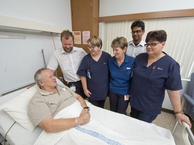 FULL OF PRAISE: Patient Arthur Laing (left) with hospital staff who came to the aid of a man in his room. From left: Tyrone Dungey, Kerry Harman, Jenny Finnerty, Dr Sanchu Jose and Kinda Graus. Photo: Adam Hourigan / The Daily Examiner