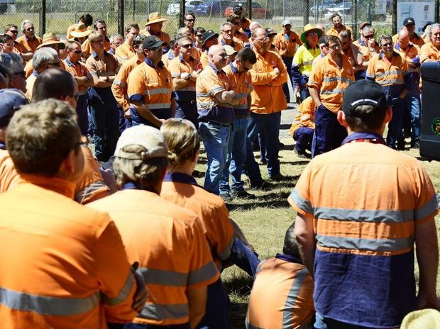 INCENSED: Aurizon workers hold a lunch time meeting with union officials after 85 redundancies were announced.