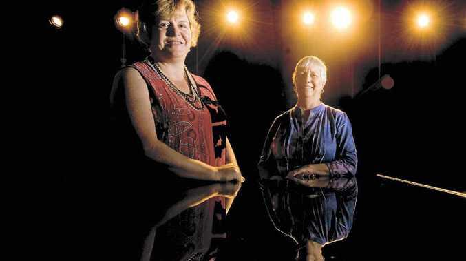 CHANGEOVER: New Clarence Valley Conservatorium director Fiona Scott, left, with retiring director Gaye Harlow on stage at the conservatorium. Photo: Adam Hourigan