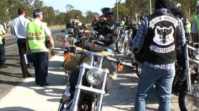 Gladstone police intercept 10 Black Uhlans motorcycle gang members on their way south.