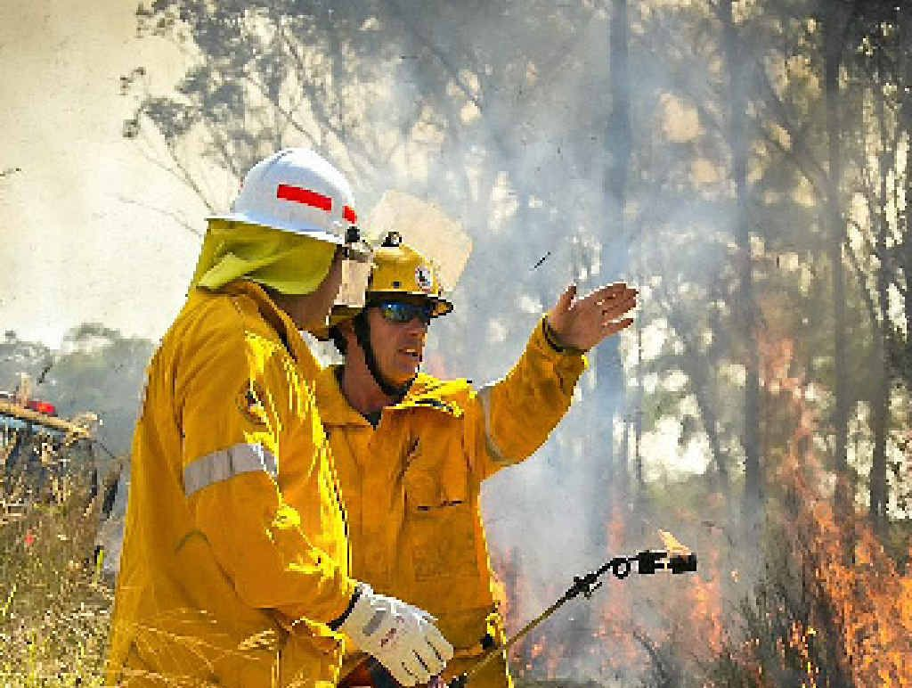 NO TO KEELTY: Rural firefighters performing precautionary back-burns on Gladstone-Benaraby Rd recently.