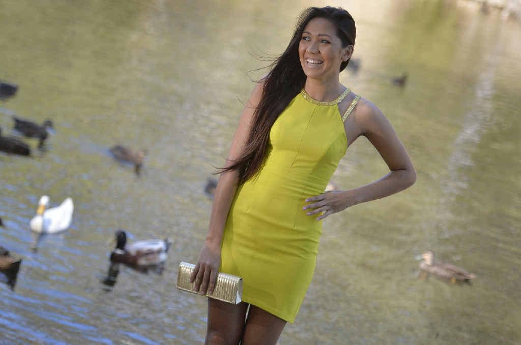 Charisse Jones, 19, wears Lumier gold strap mini dress (citrus), $139.95.