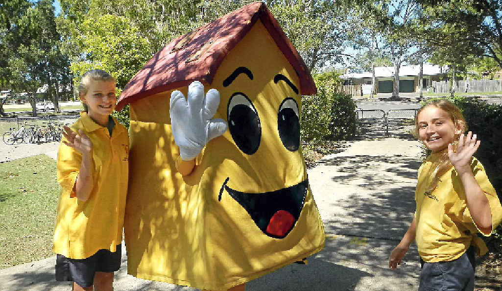 THAT'S ALL FOLKS: The IMA Safety House mascot waves goodbye at Pacific Paradise State School.